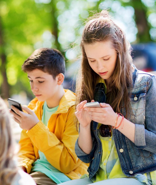 Teenagers on smartphones